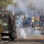 """Thousands Are Starving"": Protesters Clash With Soldiers as Coronavirus Cases Soar in Chile"